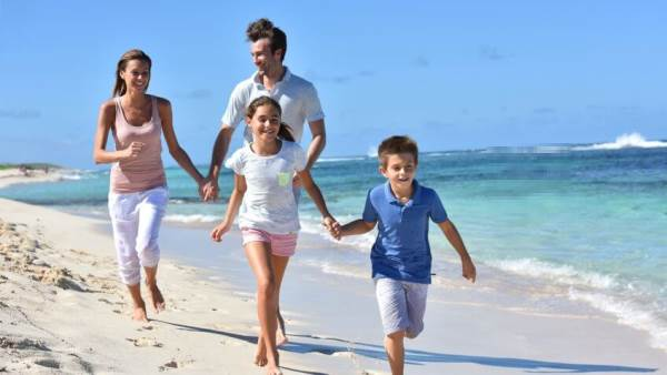 Family on vacation (stock photo), partially damaged and repaired by our technology. Can you see the difference?